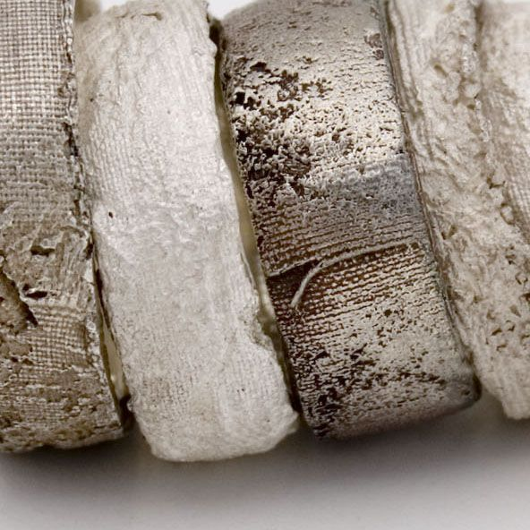 Textured Metals - silver silk cast rings with beautiful wrinkled & frayed fabric textures; art jewelry; contemporary jewellery design // Maya Kini