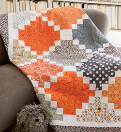 This quilt pattern featured in Quilty September October 2013 features juicy oranges gray fabrics that come together to create a simply modern quilt  Quilt by Cynthia Brunz