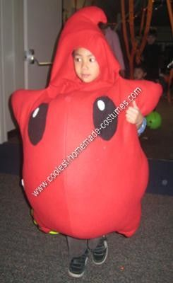 """Homemade Red Luma Halloween Costume Idea: My sons are big fans of the Super Mario Games. They've been watching me play Super Mario Galaxy for a while.  One of the """"characters"""" in the game is a"""