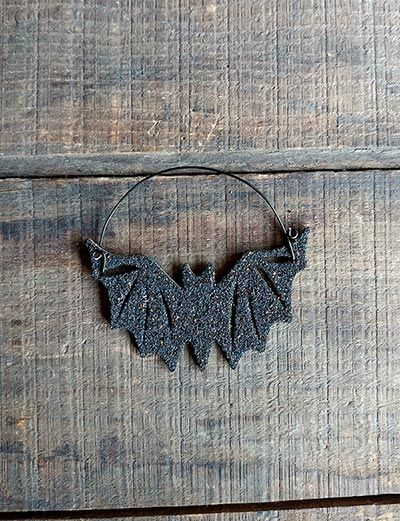 Add a vintage look to your spooky Halloween display with this black bat ornament! Made of 1/8 inch thick wood, painted black, and coated with a homemade blend of glitter for a one-of-a-kind, unique effect!
