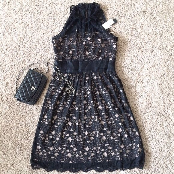 Beautiful  Black Lace Dress Petite Hits above knee. Inside is nude pink tube and outside is a beautiful lace halter. Button in the back neck, side zip. Retails for $175. Pls bundle and help me clean my closet, you'll also receive 15% Banana Republic Dresses