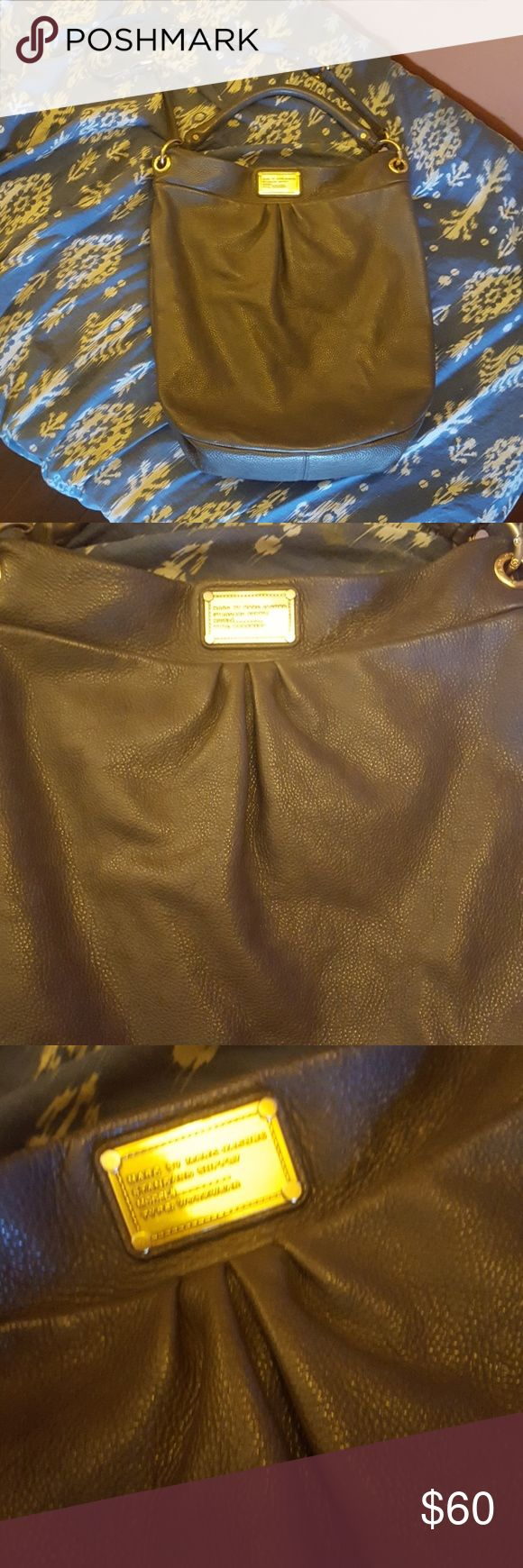 """Marc By Marc Jacobs Gray Q Hillier Hobo Classic Q Hillier oversized hobo bag by Marc Jacobs. Really cool gray color with gold hardware and crossbody strap. Super soft leather. Measures 14.5"""" across, and 16"""" high. NOTE: This bag is in pre loved condition, but still has TONS of life left. Has no stains, but the leather is discolored in certain spots, and has a TINY crack/slit near the top. My home and I are smoke free. BUT, I USED to be a smoker. To me the bag has no smoke odor, and it has…"""