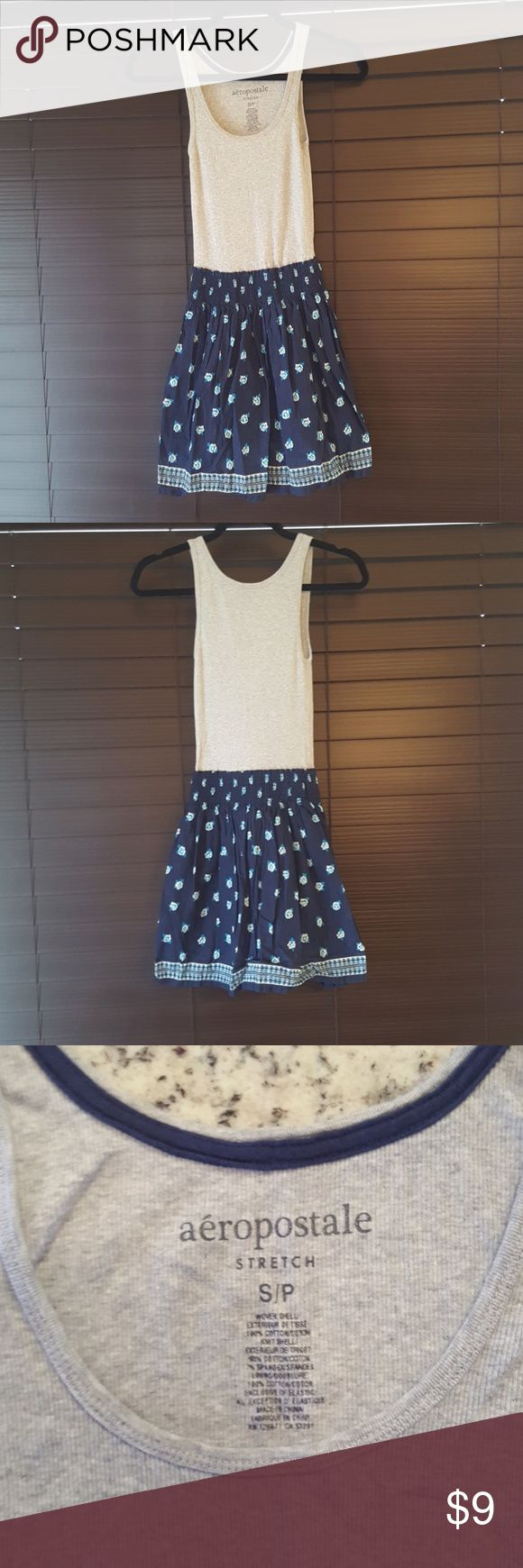 "Aeropostale Tank Top Dress - Small This Aeropostale tank top dress is perfect for the spring or summer time. Beautiful navy floral ""skirt"" makes it easy to dress up or down. Dress has lining.  ""Tank"" - 93% cotton/7% spandex ""Skirt"" - 100% cotton Lining - 100% cotton Aeropostale Dresses"