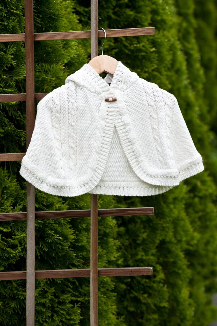 At Linens & Lace and all things lovely we carry a beautiful line of baby clothing. A variety of knit wear for christening and baptisms and everyday wear for your little one. This lovely knit cape with toggle comes in sizes 6-24 month. Visit us at www.linensandlace.ca