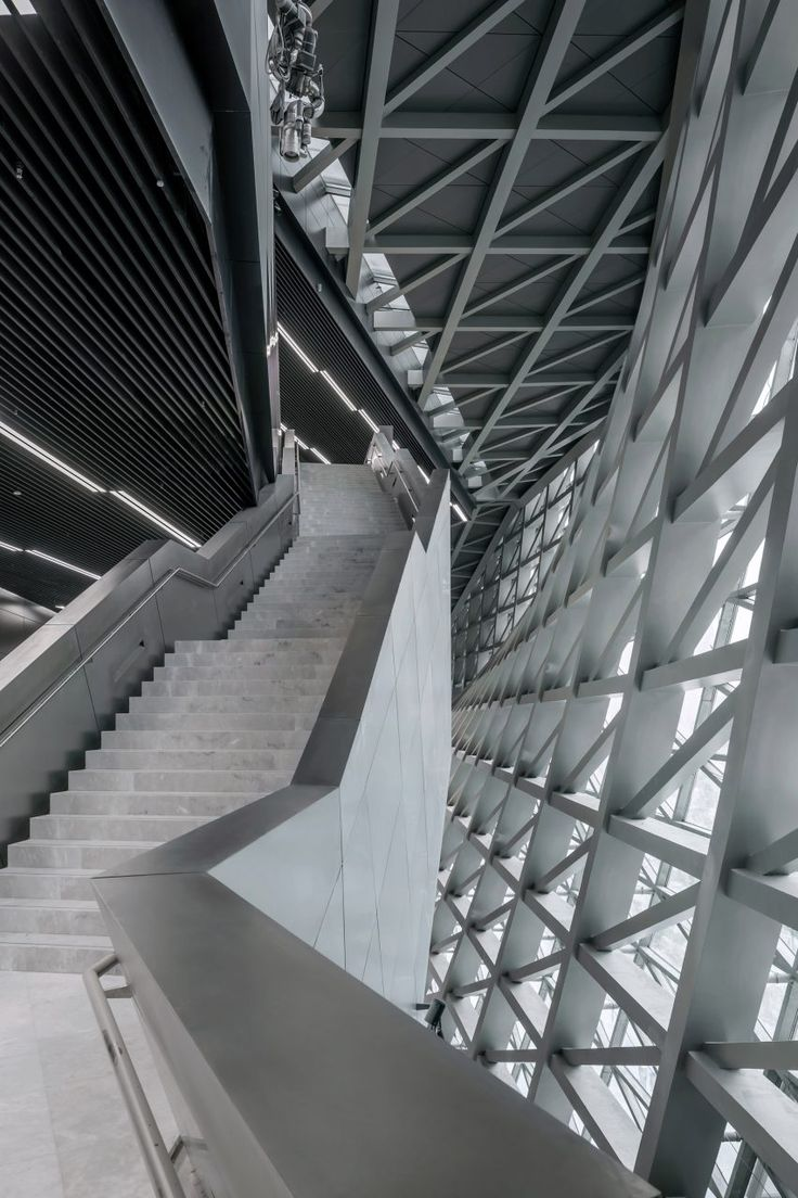 Ramps, stairs and escalators lead visitors up into the heart of this complex, where a plaza links the exhibition spaces with a shared multi-functional hall, auditoriums and a library.