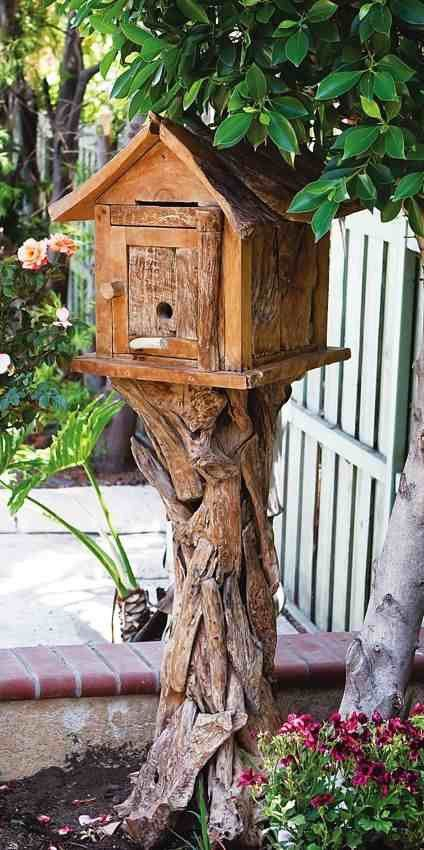 Teak birdhouse is nestled on its own driftwood pedestal. Handcrafted from reclaimed materials, this bird home makes for the perfect nesting site and roost for cold nights. Standing 5 feet tall, it's a