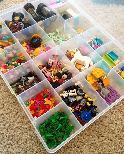 Immy recently asked to move our Lego collection into her bedroom as a way to help protect her creations from toddler-sized fingers. I knew we would have to find a simple-to-maintain system for playing with, organising and storing the Lego if I wanted to prevent it from taking over the whole room and with a dedicated play table and two handy storage boxes I think we might have done just that. Here's how it looks... In a divided underbed storage box we have sorted the Lego...  From top to ...