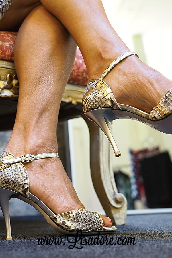 Golden shoes with gold high heels. Comme il Faut. World's