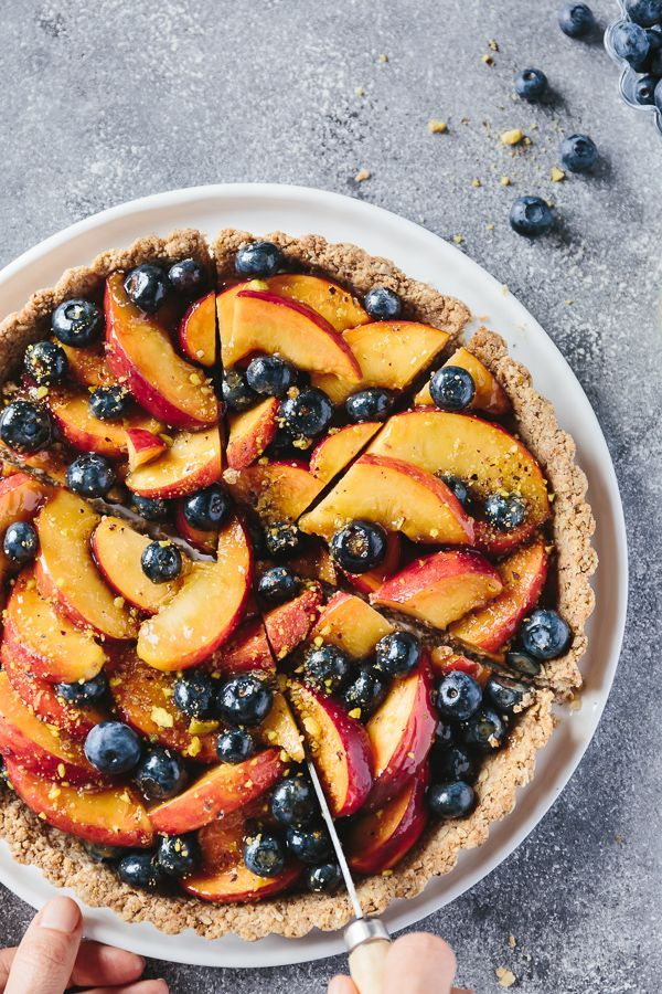 Fresh Peach and Blueberry Tart with Walnut Crust by foolproofliving: Refined sugar free, vegan, and ready in under an hour and a half. A healthier alternative to the buttery summer fruit tart we all love. #Tart #Peach #Blueberry #Quick #Easy #Healthier