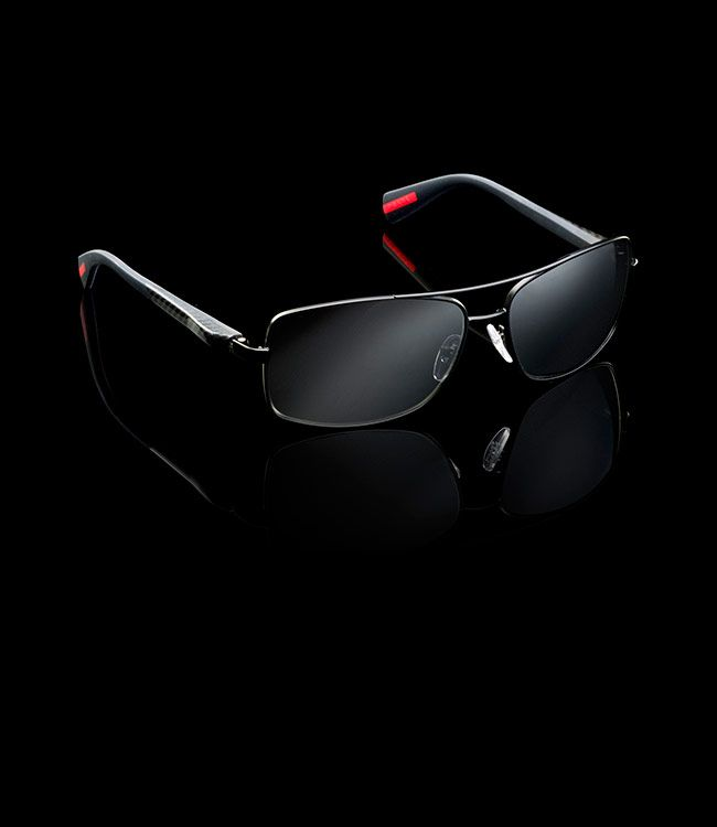 Prada | Sunglasses | 2014 | CLASSIC OPAQUE BLACK FRAMES WITH HIGH TECH BLACK NETEX AND CARBON TEMPLES LINEA ROSSA LOGO | COLOR: MIRRORED CHARCOAL SPS50O_E1BO_F07W1 | PRICE €250