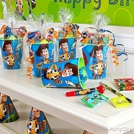 toy story birthday favors, plastic cups filled with treats, pop in celaphane bags and tie with ribbon