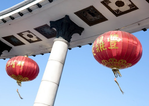 Iconic red Chinese lanterns hang in a passageway welcoming visitors to the city of Harbin.    #lantern #red #China #ICPC2010