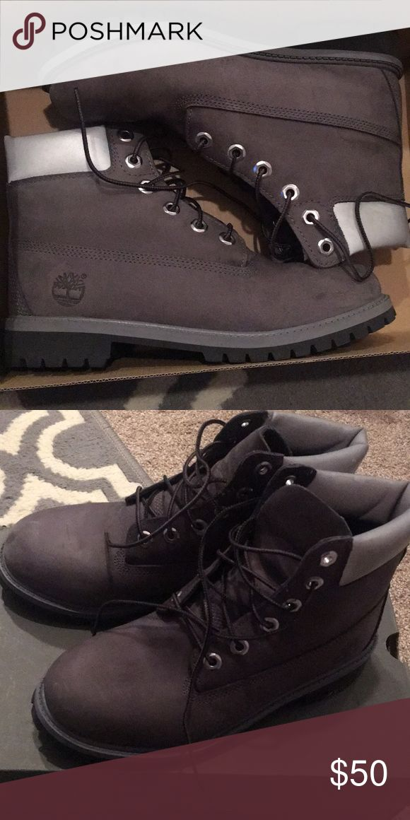 Dark grey timberland boots kids 6 (women's 8) Dark grey timberland boots with black bottoms. I apologize the tag fell off. Still in box condition, bought them from finish line. Timberland Shoes Combat & Moto Boots