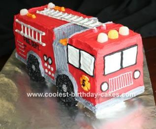 3 D Fire Truck Cake: This is my first fire truck cake. I used the 12x18 sheet pan - I made 2 cakes (4 cake mixes). I cut each cake in half and filled it with buttercream. The