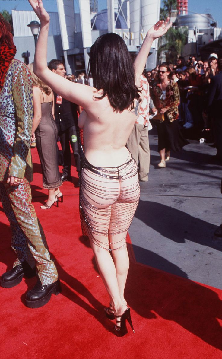 Barely There. Rose McGowan shocked at the 1998 VMAs, her outfit literally hanging by a few threads.