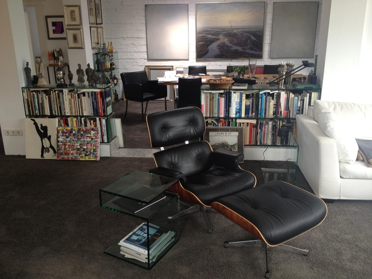 """Picture made in a """"Designer's flat"""" in Berlin, showing Vitra Eames Lounge Chair and JANUS III + custom made shelfs by DREIECK DESIGN."""