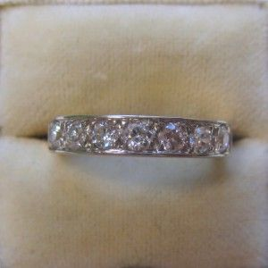 Diamond half eternity engagement ring
