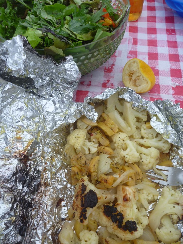 healthy camping food Chop up cauliflower,   yellow squash, onion, and small potatoes.  Sprinkle with olive oil, salt, and   pepper.  Throw in a little feta cheese and double wrap in foil.