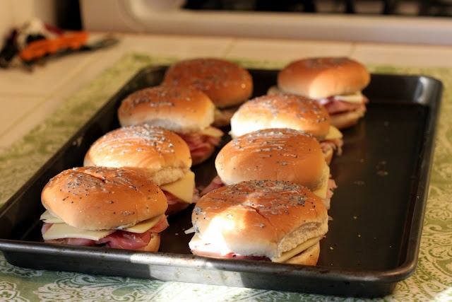 Ham & Cheese with mustard & seasoned butter, wrapped in foil individually, frozen, then baked as needed. I'm going to try with smaller buns though.
