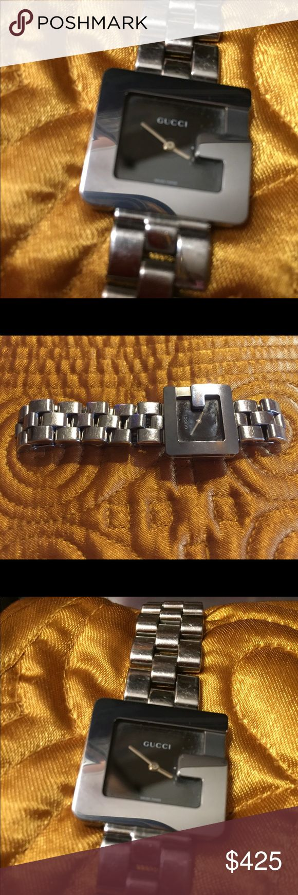 """Authentic lady's """"G Gucci"""" stainless steel watch. case:polished stainless steel caseback : stainless screw in Black face; Markers silvertone indices; Bracelet stainless steel clasp. dust bag and a box. Note: The box and bag are not marked;(is what I received when bought) Gucci Accessories Watches"""