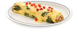 Spinach, mushrooms, onions and Swiss cheese, topped with hollandaise and diced tomatoes, order one today from the Omelettes menu at IHOP.