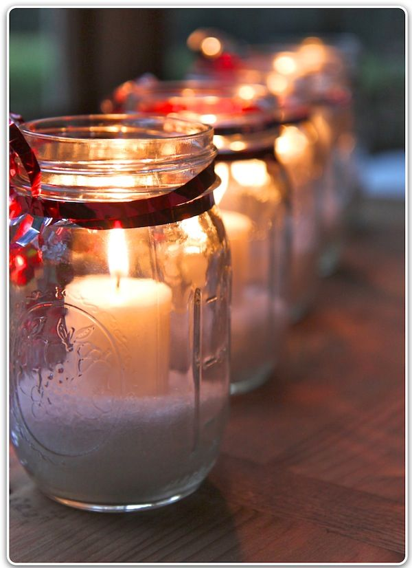 For these candles, use Mason jars, Epsom salts and little candles. Tie some ribbon and an ornament around the top. Candles in glass holders work much, much better - they burned for hours, and the wax doesn't run all over the Epsom salts.