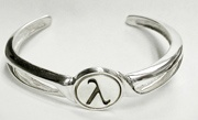 """Lambda- Sterling Silver Bracelet:       THE LAMBDA SYMBOL: is a symbol of both """"Liberation"""" and """"Unity"""". In 1974, the Lambda was officially declared the international symbol for gay and lesbian rights by the International Gay Rights Congress.   In chemistry and physics, lambda indicates energy in equations. It is often used to represent differing wavelengths of certain types of energy, reflective perhaps of the differing sexual energies between heterosexual and homosexual interactions."""