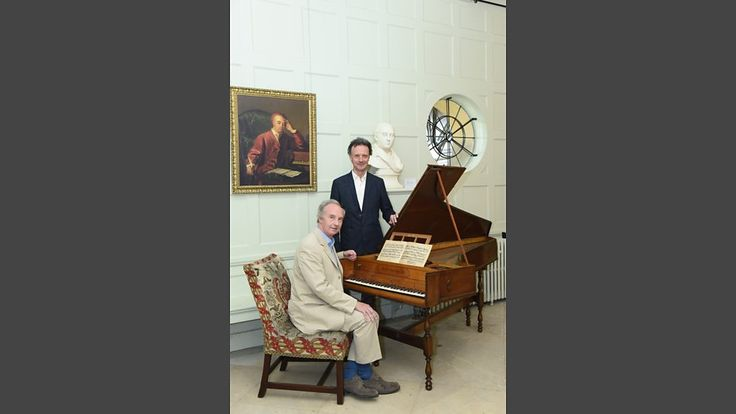 Duke of Buccleuch at Handel's harpsichord, with curator Paul Boucher at Boughton House. (976×549)