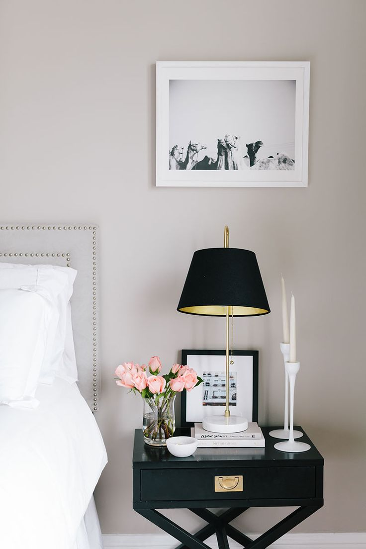 traditional bedroom with black nightstand, black and gold lamp