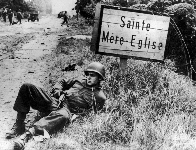 An American GI pausing during a march from Ste.-Mère-Église, France, on June 7, 1944.
