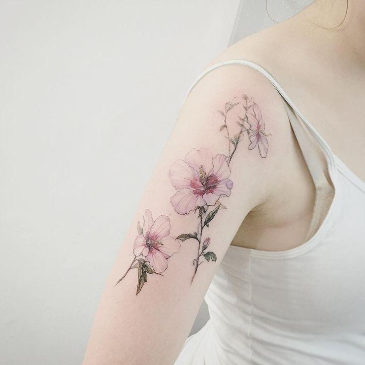 Super delicate botanical flower tattoo