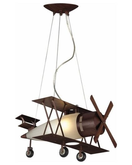 Soaring above the room, this vintage plane pendant lamp casts a warm glow over its flight path.