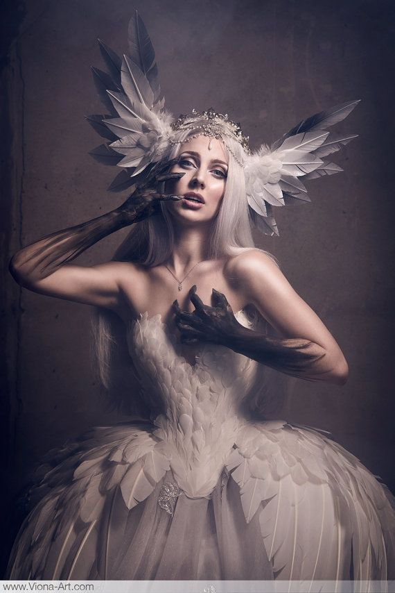 Swan feather headdress. (circlet and crown not included)  The swan wings attach to a headband (hair is brushed over the headband in the pictures), for