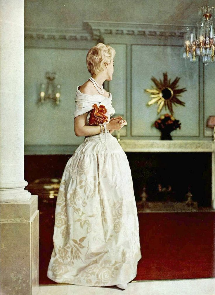 Model in beautiful evening gown of vanilla cut-velvet, with crossed fichu a la Marie-Antoinette, by Jacques Griffe, photo by Georges Saad, 1957