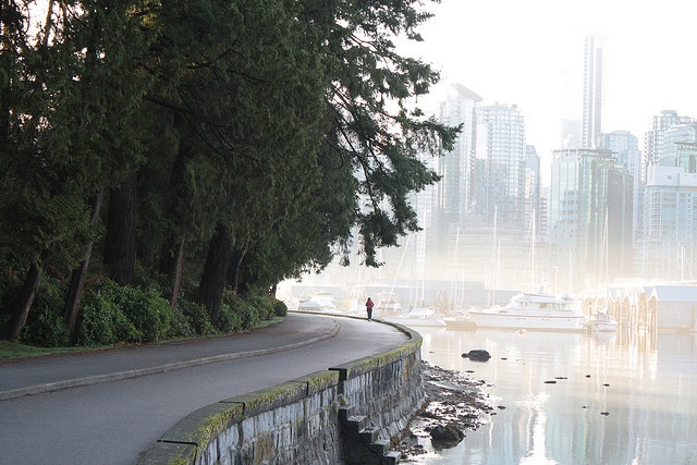 The road looks decades old but the city in the background looks sci-fi-ish. Vancouver, BC