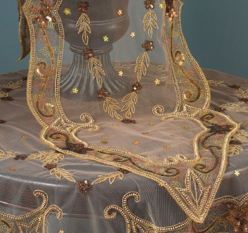 """Gorgeous Hand Beaded Gold Jasmine Table Runner. 16""""x72"""" Hexagon. One Piece. by Fennco. $49.99. Made of polyester and beads. Original Price: $112. Dry clean; imported. Measures 16 inch by 72 inch. This stunning table runner hand beaded in gold Jasmine design will add a luxurious touch to your seasonal table. It's amazing in any occasion and will become an valuable addition to your decor."""