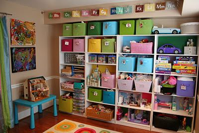 This mom is A-MAZ-ING!  Former art teacher with TONS of great ideas for organizing kid-friendly spaces!  Pink and Green Mama: Kid-Friendly Spaces and Toy Storage Solutions In Our Home