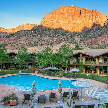This would be a really great place to stay for my honeymoon. I love the pool surrounded by the green grass and chairs. The view of the mountains is fabulous as well.