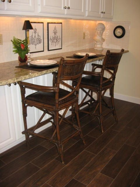 More faux wood tiles in action. This is such a great kitchen dining look!
