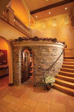 Wine Cellar Design Ideas, Pictures, Remodel and Decor. Love this round wine cellar utilizing the space under stairs.