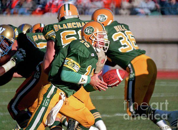 Edmonton Eskimos QB Matt Dunigan #16 ready to hand off the football on this play versus the Winnipeg Blue Bombers, 1987.