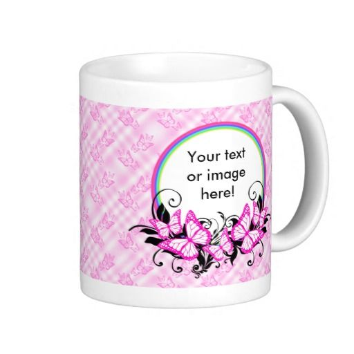 Pink White Black Butterflies And Rainbows Mugs - This design features pink butterflies with white wings sitting on a rainbow and black, curly, swirly leaves. The background has a pink and white tartan style with lots of pretty pink butterflies arranged in a pattern all over. This mug would make a special, personal mothers day gift, Christmas present, best friend gift, wedding gift or a gift for the the bride!