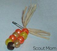 Indian Corn - Pony beads threaded onto raffia; tied on top.  I made these for Fall Frolic Camp 2011.  www.scoutmom.net