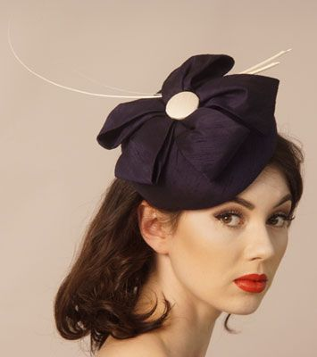 Navy silk dupion headpiece with ivory quills by Judy Bentinck