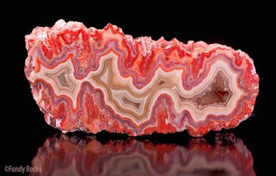Fortification Agate Agate with sharp-angled bands which resemble the outlines of…