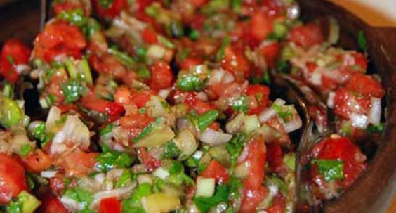 Pebre is a Chilean condiment made of coriander, chopped onion, olive oil, garlic and ground or pureed spicy aji peppers. If you add chopped tomatoes it is called chancho en piedra. Pebre is most commonly used on bread. It is also used on meat, or when meat such as Choripán is provided in a bread roll.