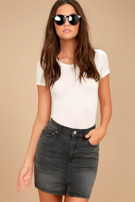 Embrace the sunshine in the Billabong Black Magic Washed Black Denim Mini Skirt! Stretch, washed denim falls from a belt loop-accented waistband into a five-pocket cut and a short, flirty hem with front slit. Branded top button and zip fly. Logo tag at back.