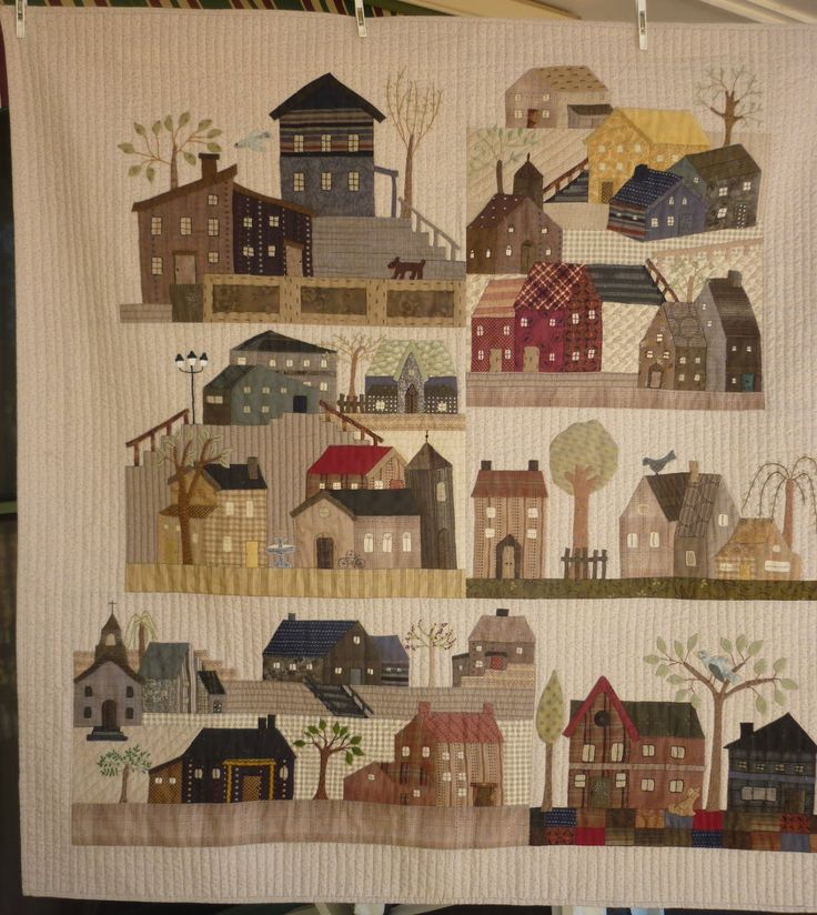 I finished  machine quiltingmy wallhanging with the houses. I try and do the smaller quilts I make and leave my large quilts to the p...