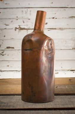 Rustic and unique, this metal decanter or vase is a wonder accent piece - use as…