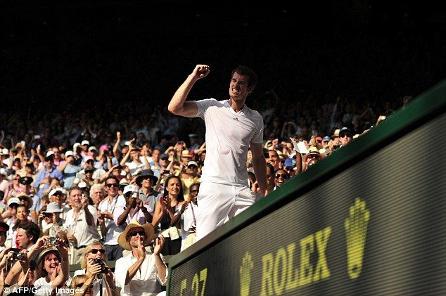 Murray celebrates on his way to celebrate with the fans after winning the Wimbledon title